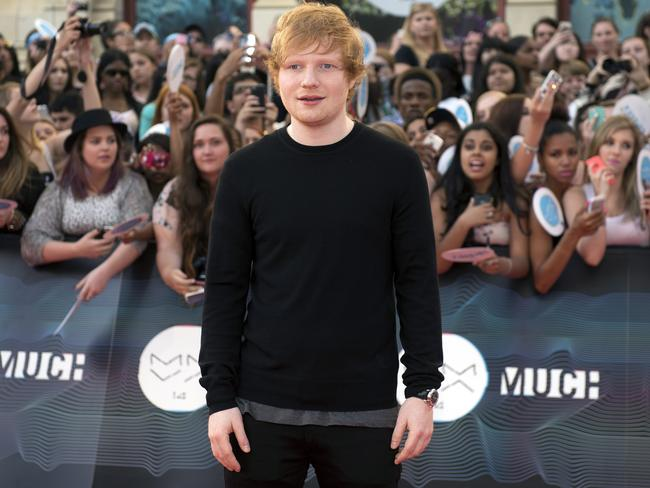 Sheeran poses on the red carpet at the 2014 Much Music Video Awards in Toronto this month.