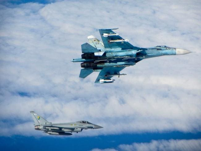 "Baltic stand-off ... A ""Typhoon"" interceptor of the Royal Air Force flies beneath a Russian Su27 ""Flanker"" combat jet over the Baltic Sea in June. Picture: Royal Air Force"