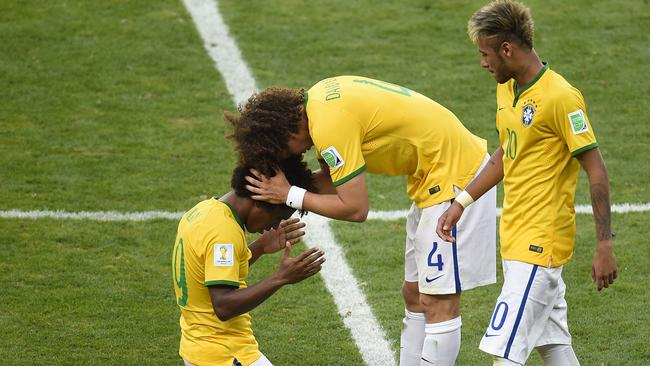 (From L-R) Brazil's forward Fred, Brazil's defender David Luiz and Brazil's forward Neymar.