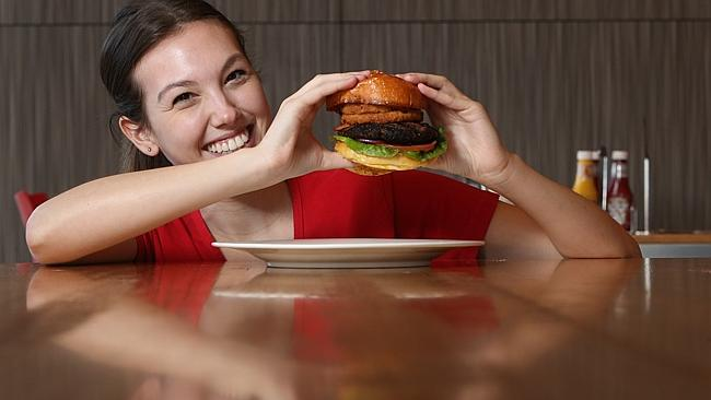 Jennifer Vastone of Burger Club at Mawson Lakes with the Texas Club Burger. Picture: Tait Schmaal.