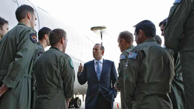 Full support...Tony Abbott speaks to deploying troops at RAAF Base Williamtown ahead of their involvement in Iraq. Picture:CPL Melina Young/RAAF via Getty Images