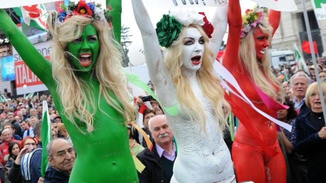 Femen activists protesting against then-Italian leader Silvio Berlusconi.