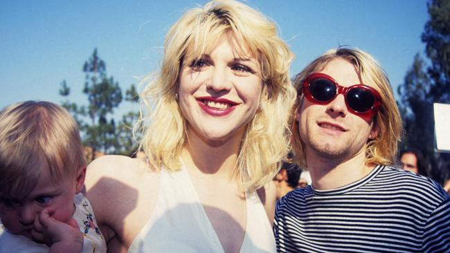 The first family of Alt Rock: Kurt Cobain of Nirvana (right) with wife Courtney Love of Hole and daughter Frances Bean Cobain (Photo by Terry McGinnis/WireImage)