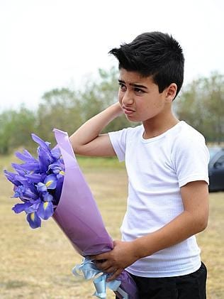 Jad Rashid goes to the same school as Luke and came with his father to leave flowers at the oval. Picture: Ellen Smith