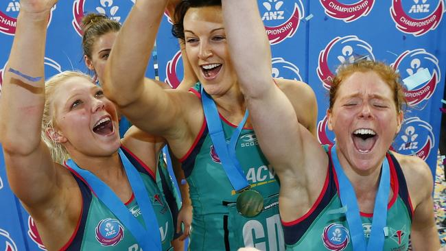 Bianca Chatfield, Tegan Caldwell and Kate Maloney celebrate winning the ANZ Championship. Picture: Michael Klein.
