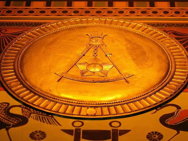 The Masonic square and compasses symbol is seen on the main floor wall frieze at the headquarters of the Scottish Rite of Freemasonry, USA in Washington, DC. Picture: AFP Photo/Tim Sloan