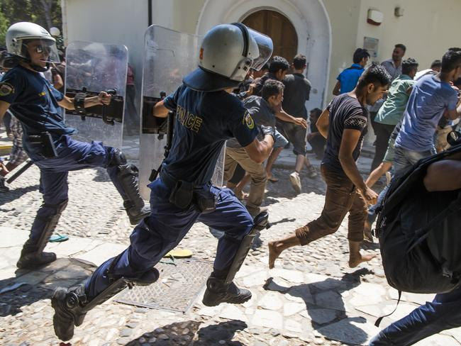 Greek riot police are trying to control the refugees by chasing them away from areas of Kos.