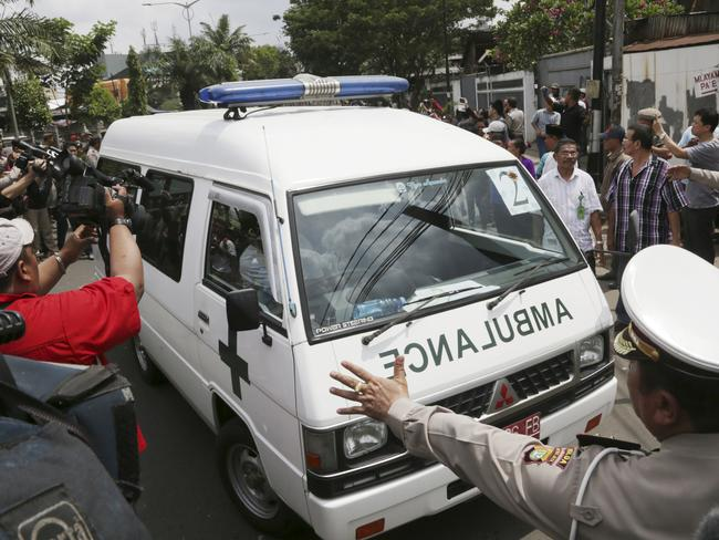 The journey home ... one of ambulances carrying the bodies of Australian death-row prisoners Andrew Chan and Myuran Sukumaran arrives at a funeral home in Jakarta. Picture: AP Photo/Achmad Ibrahim