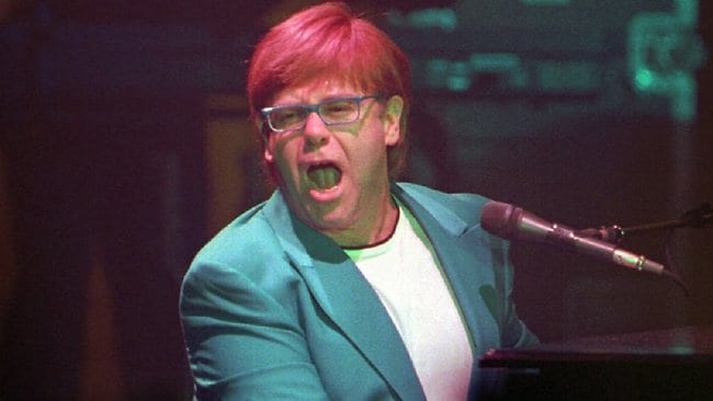 Singer Elton John performs at the Roxy Theatre in Atlanta, Georgia, in October 1998.