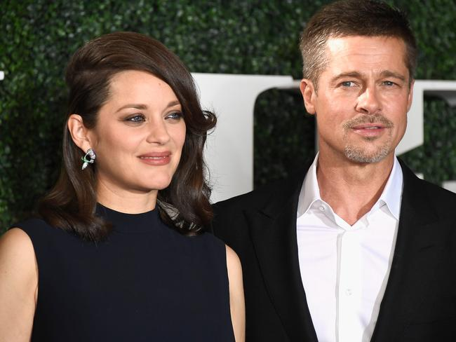 Marion Cotillard and Brad Pitt attend the fan event for Allied. Picture: Getty