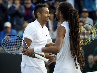 Nick Kyrgios of Australia, left, shakes hands with Dustin Brown of Germany after beating him in their men's singles match on day five of the Wimbledon Tennis Championships in London, Friday, July 1, 2016. (AP Photo/Alastair Grant)