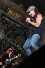 "<p>Singer Brian Johnson and guitarist Angus Young of band AC/DC perform for the fans in Wellington, New Zealand.""</p>"
