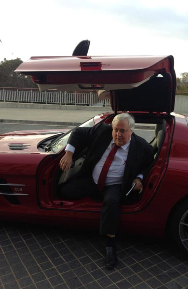Clive Palmer arrives at parliament in style in his Mercedes sports car.