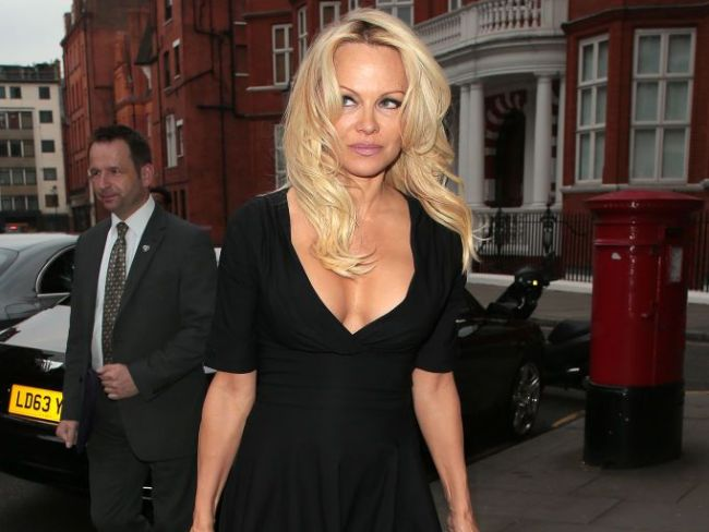 Pamela Anderson arrives to visit Assange at the Ecuadorian Embassy, May 2017, in London. Photo: Ricky Vigil/GC Images/Getty.