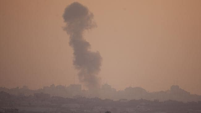 Heavy shelling ... a smoke plume rises over Gaza following an Israel air force bombing, as seen from near Sderot in Israel. Picture: Lior Mizrahi/Getty Images