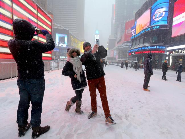 Even a blizzard couldn't stop the selfies in Times Square. Picture: Nathan Edwards