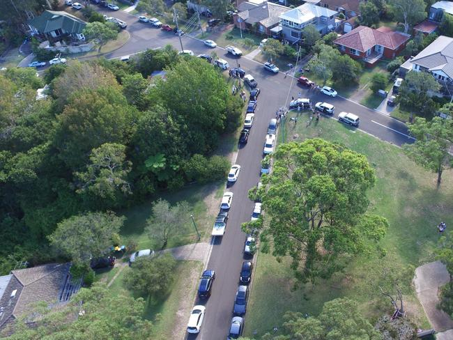 An aerial picture of a boarding house protest on the northern beaches.
