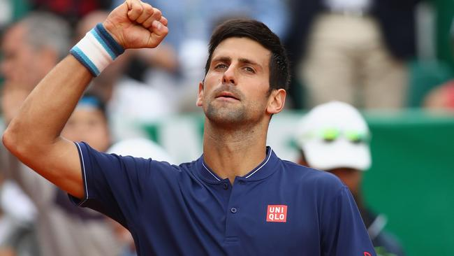 Novak Djokovic of Serbia celebrates to a throng after his 3 set victory.