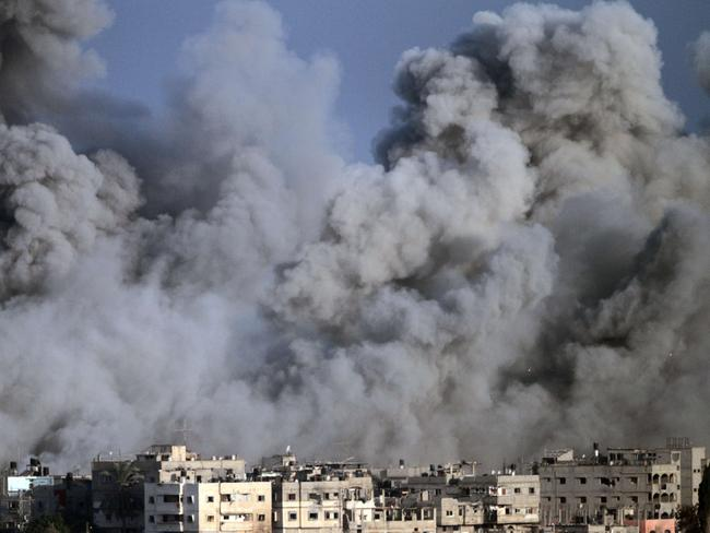 Volcanic fury ... Smoke and debris fill the air during an Israeli strike on Gaza City.