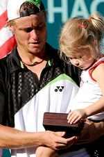 <p>Lleyton Hewitt shares his prize with his daughter Mia (3) after beating Odesnik to win the USA Mens Clay Court Championship in Houston, in April 2009.</p>