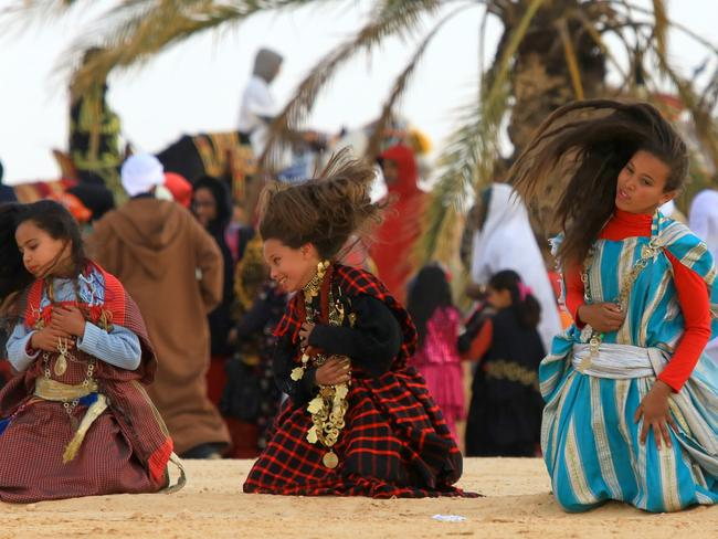 Berber girls partake in a traditional dance. Picture: Jakub Kyncl