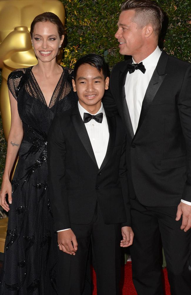 Angelina Jolie, Brad Pitt and their son Maddox at the 2013 Governors Awards. Picture: Robyn Beck.