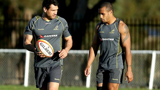 FIT AND AVAILABLE: George Smith talks with Will Genia during Wallabies training in Sydney. Picture: Gregg Porteous