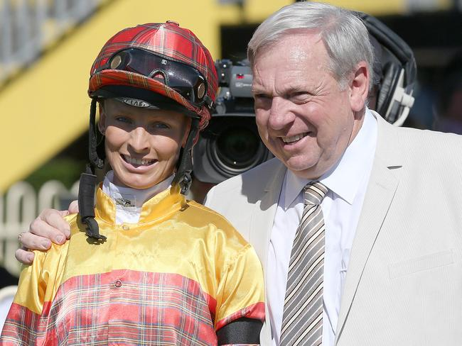 Janette Johnson and Bryan Guy pose for the media after a recent Doomben win. Picture: Jono Searle.