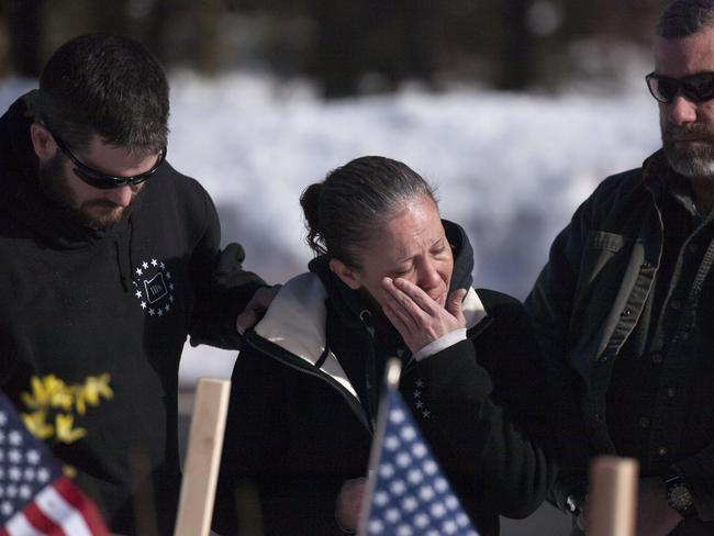 Emotional ... Brooke Agresta of the Idaho Three Percenters patriot group wipes away tears at the site where LaVoy Finicum was shot and killed. Picture: Matt Mills McKnight/Getty Images/AFP