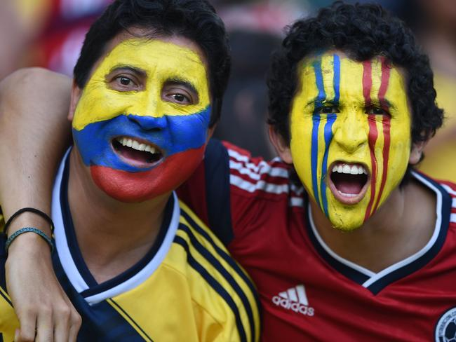 Colombia's fans cheer prior to the Round of 16 football match between Colombia and Uruguay.