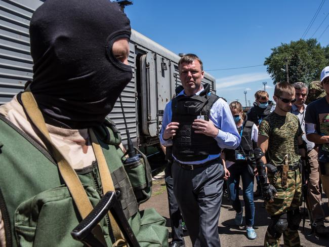 Alexander Hug (C), Deputy Chief Monitor of the Organisation for Security and Cooperation in Europe (OSCE) Special Monitoring Mission to Ukraine, visits a train containing the bodies of victims of the Malaysia Airlines flight MH17 crash on July 21, 2014 in Torez, Ukraine. Together with Dutch inspectors, the storage conditions were declared acceptable, though it is still unclear where or when the train will be moved. Picture: Getty