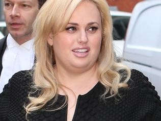 Actress Rebel Wilson arrives at the Supreme Court in Melbourne with her legal team. Friday, May 26, 2017. Wilson is suing Bauer Media for publishing articles that painted her as a serial liar. (AAP Image/David Crosling) NO ARCHIVING