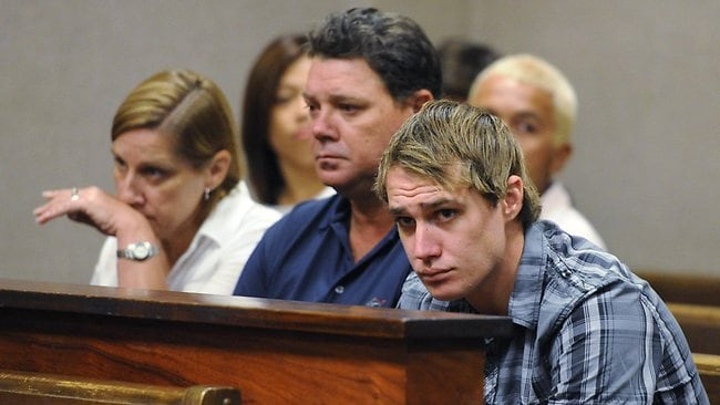 Tyson Dagley, right, sits with his parents Alan and Ann Dagley in a Honolulu courtroom Picture: AP/Honolulu Star Advertiser