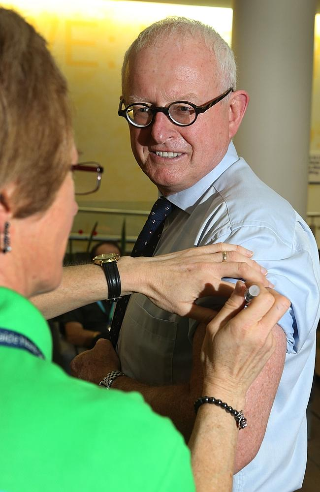 Take my advice ... South Australian Chief Medical Officer Paddy Phillips has a flu shot, encouraging everyone to get one. Picture: Dean Martin