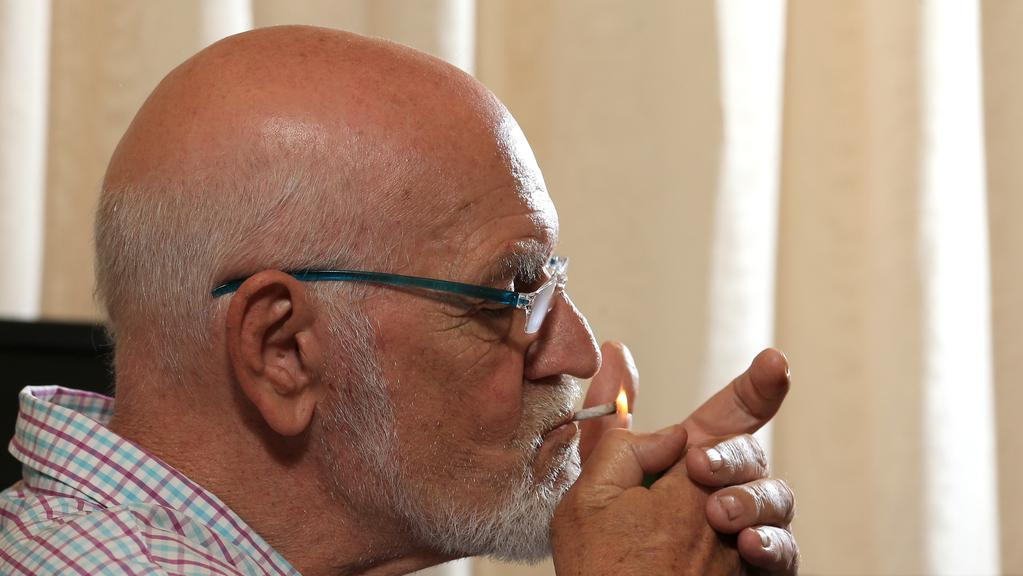 Outspoken cartoonist and blogger Larry Pickering at his residence in Bundall, Gold Coast — despite a terminal cancer diagnosis, he's continuing to smoke, refusing chemotherapy and not backing down from speaking his mind. Photo: Regi Varghese