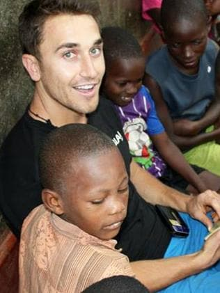 Heart of gold ... Tyson Mayr on a trip to Uganda to install water filters in impoverished villages. Picture: Supplied