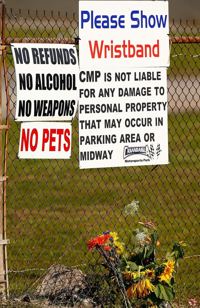 Flowers lay next to the front entrance of the Canandaigua Motorsports Park.