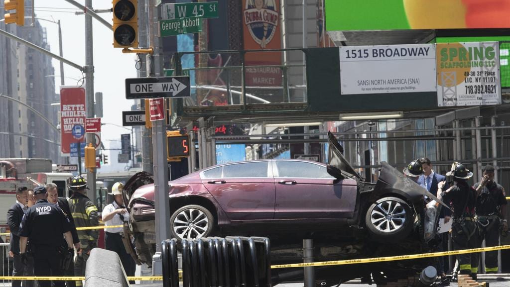 A car rests on a security barrier in New York's Times Square after driving through a crowd of pedestrians. Picture: AP