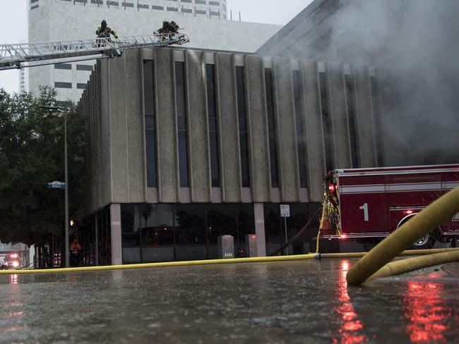 Firefighters put out a fire in Houston. Picture: Brendan Smialowski/AFP
