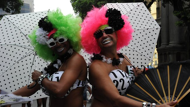 Revellers take part in the 'Cordao do Bola Preta' traditional carnival band parade along Rio Branco avenue. Picture: AFP