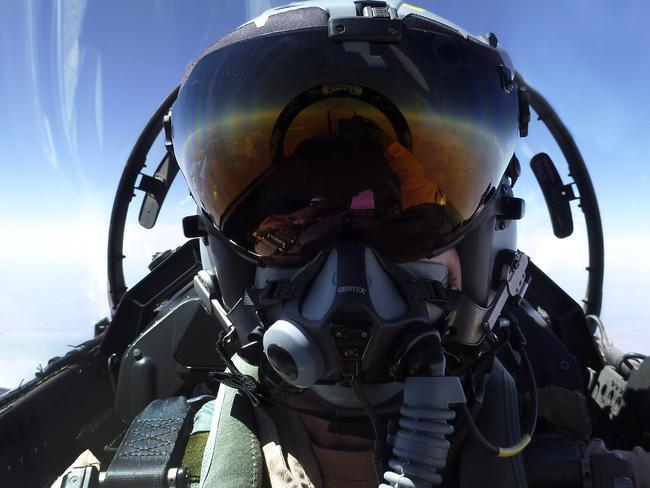 Secret mission ... A Royal Australian Air Force (RAAF) F/A-18F Super Hornet Air Combat Officer, mid flight, en route to the Middle East Region. Picture: Supplied.
