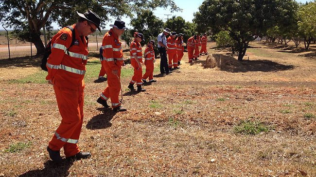 SES workers conduct a search in Charters Towers.