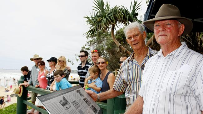 Barry and Brian O'Connor (right), who lost their younger brother Liam at age eleven, are pictured at the crash memorial at Maroochydore Surf Club. Picture: Megan Slade.