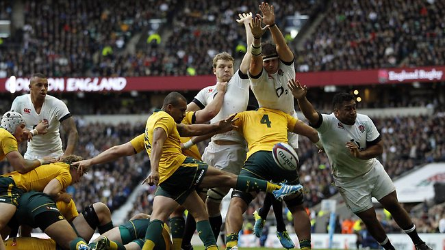 England players charge down a kick from Australia's scrum half Will Genia leading to an England try.