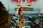 <p>Hot pants... Megan Fox returns as Mikaela Banes in Transformers: Revenge of the Fallen. In the film she works at her dad's bike shop and in a long-distance relationship with her boyfriend Sam Witwicky (Shia LaBeouf). Picture: Paramount Pictures</p>