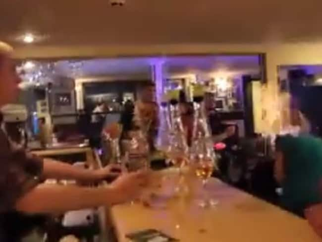 Shocking ... The bartender watches as the woman falls to the floor. Picture: Facebook