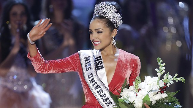 Miss USA, Olivia Culpo, waves to the crowd after being crowned as Miss Universe during the Miss Universe competition, Wednesday, Dec. 19, 2012, in Las Vegas. (AP Photo/Julie Jacobson)