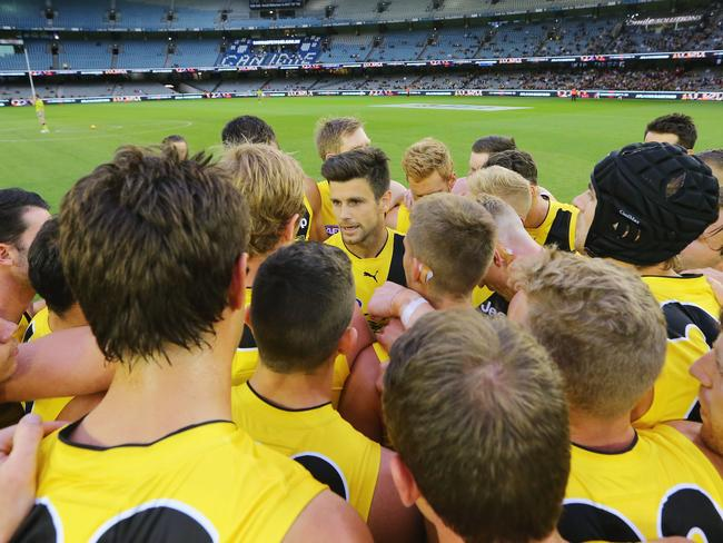 Trent Cotchin speaks to his teammates prior to the JLT Community Series clash against Adelaide.