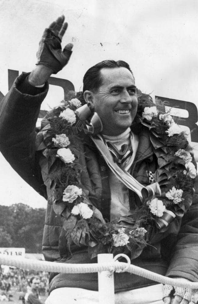 Jack Brabham salutes the crowd after winning the 1966 British Grand Prix.