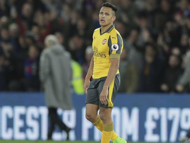 Arsenal's Alexis Sanchez looks dejected.